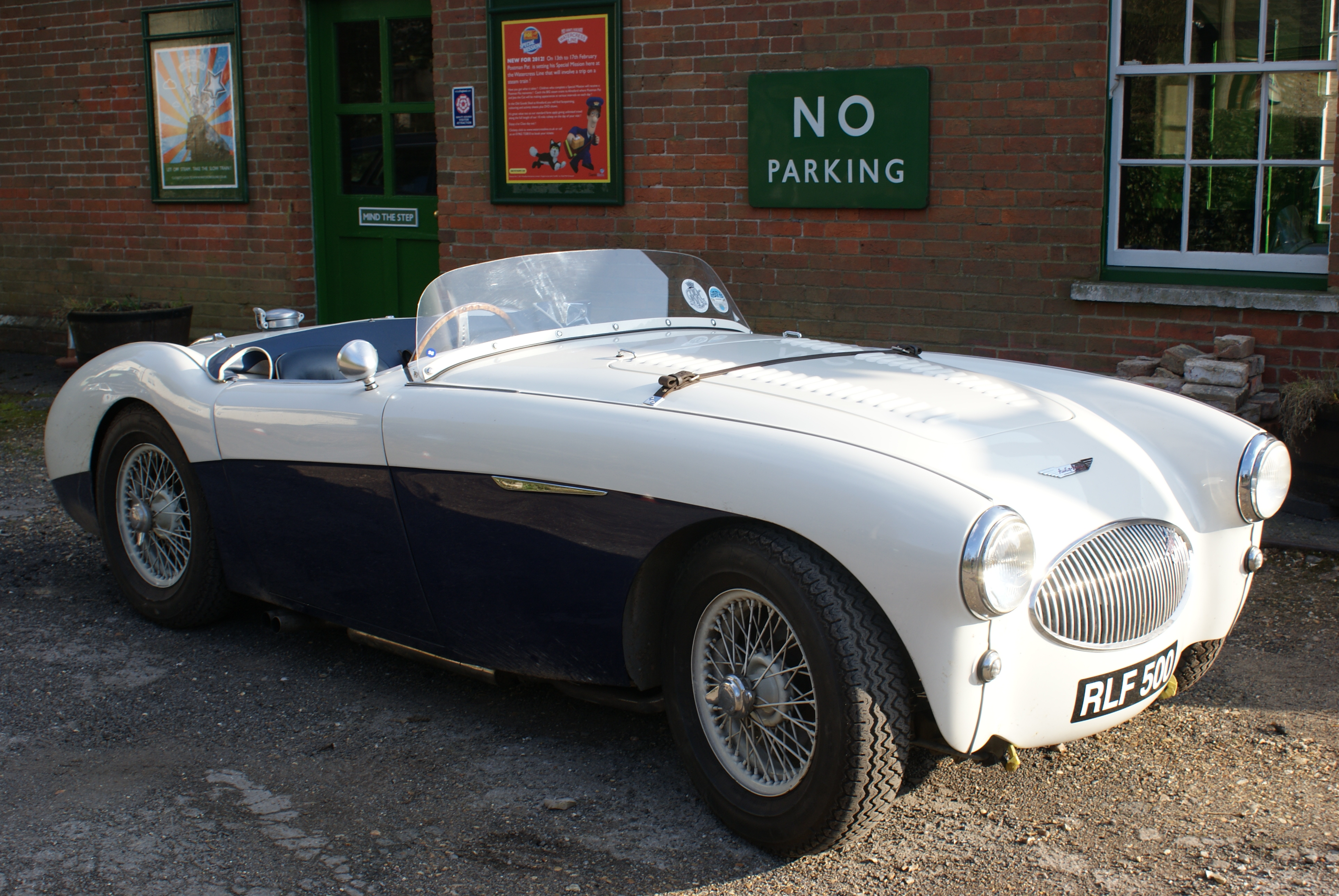 Austin Healey 100S parked at Medstead & Four Marks Watercress Line Railway Station